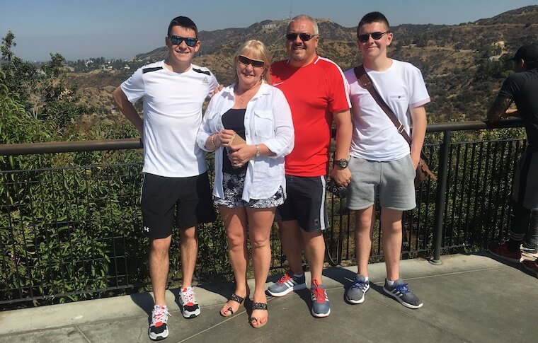 Family of Four Posing Near Hollywood Sign